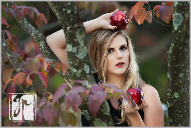 Beautiful Senior Girl Holding Red Apples
