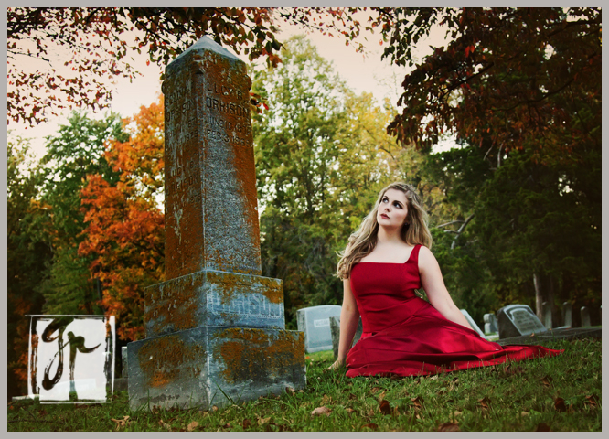 High School Senior in a Cemetery wearing a Red Dress