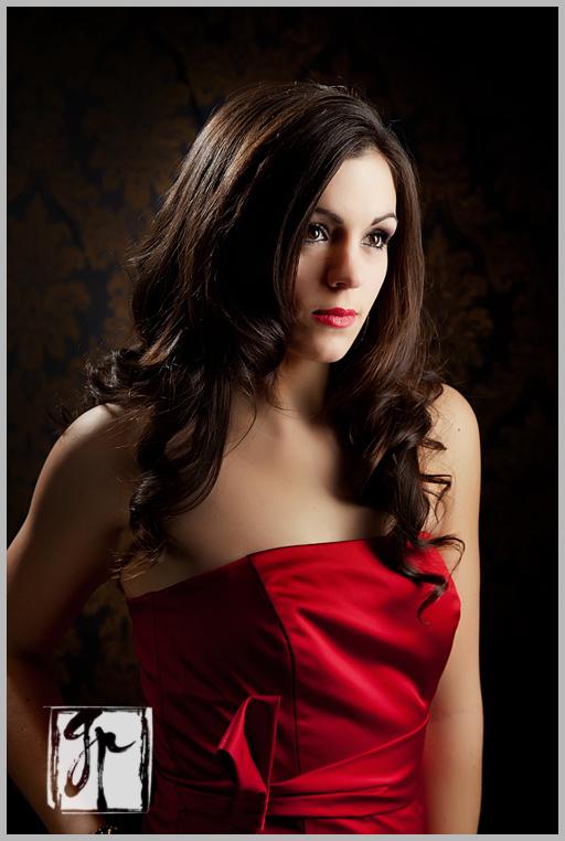 brunette in a red dress