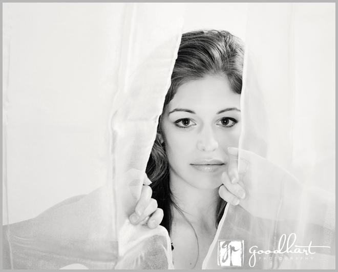 woman peeking through curtains