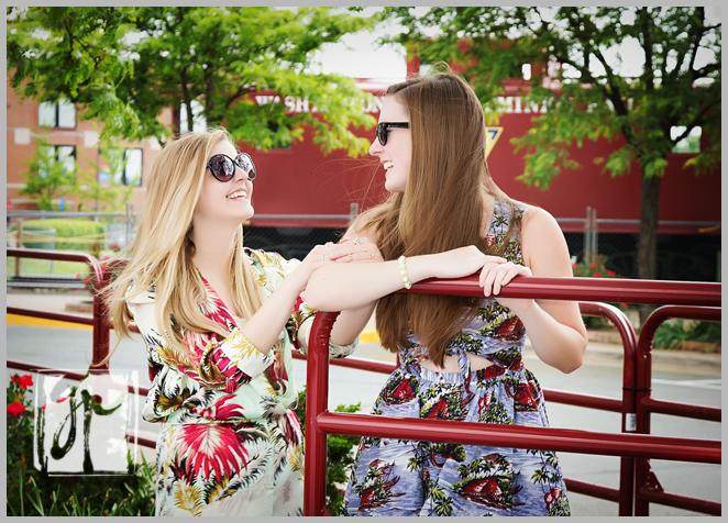 Two senior girls laughing