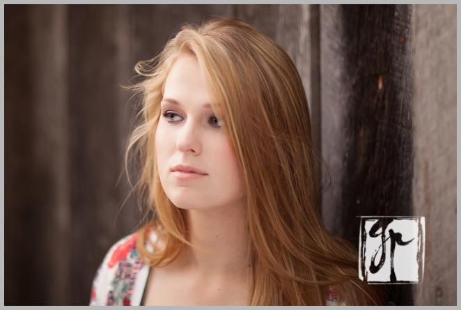 pensive high school senior girl