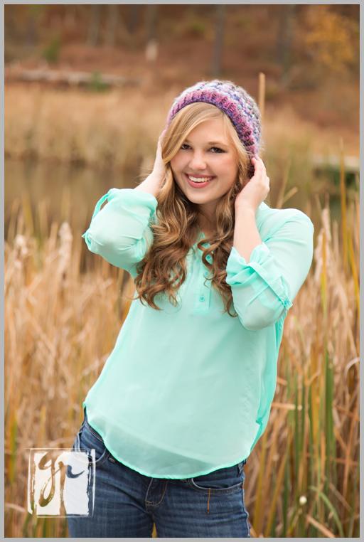 senior girl with purple hat