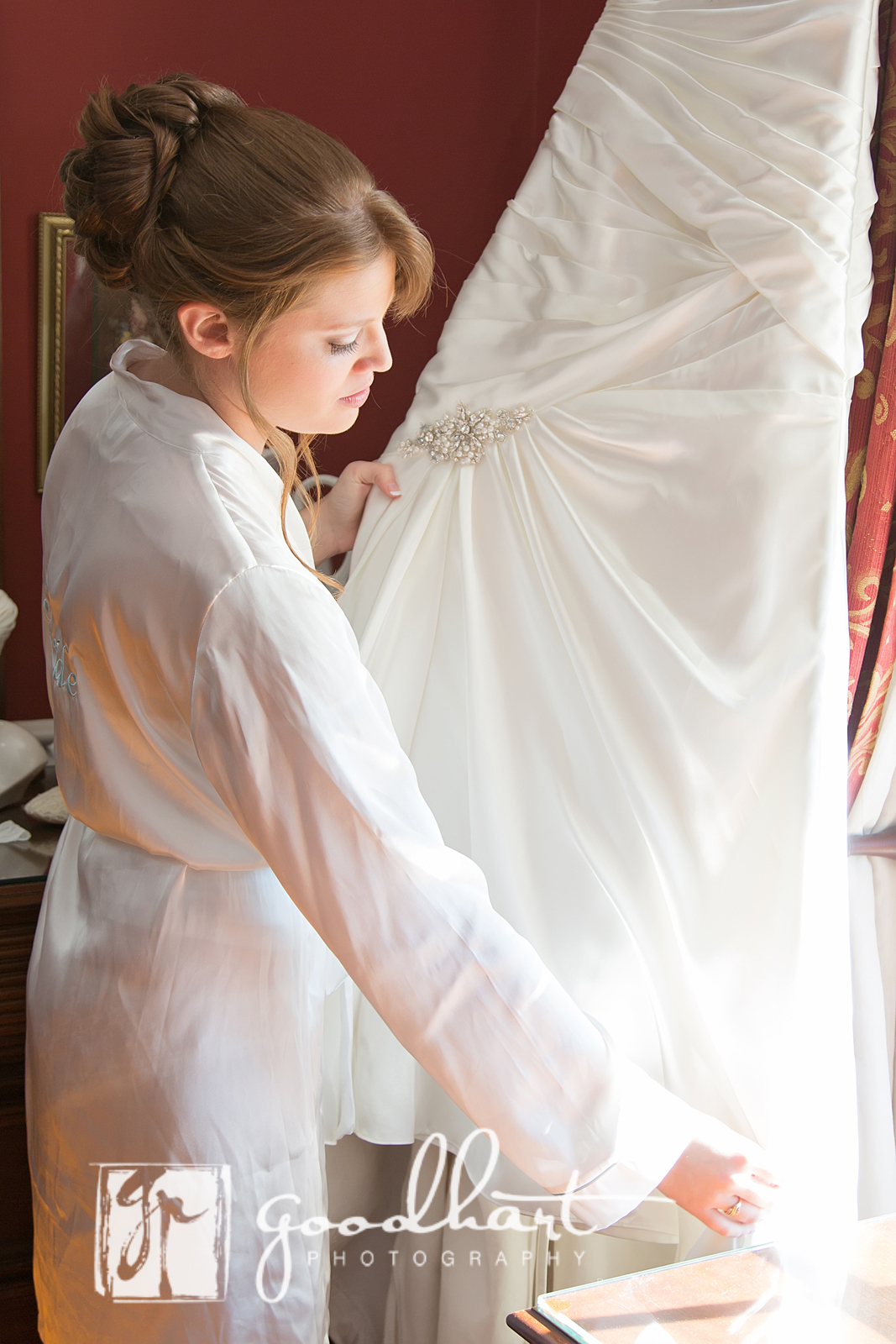 sweet bride looks at her dress