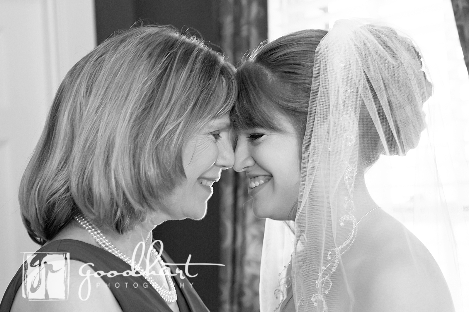 MOther of the bride and bride share a moment