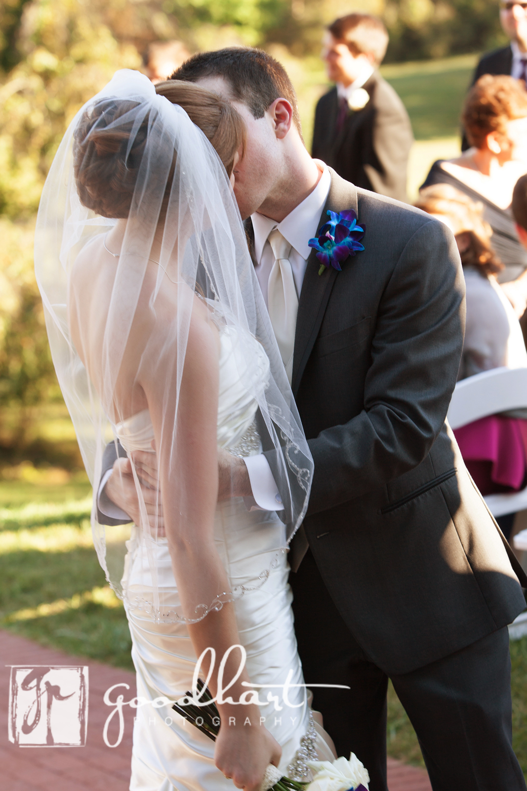 groom kisses bride in the aisle at Rosemont Manor