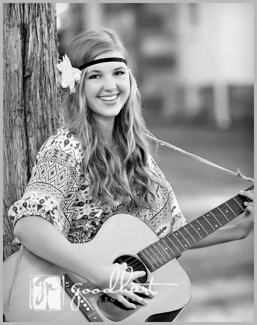 beautiful high school senior with guitar