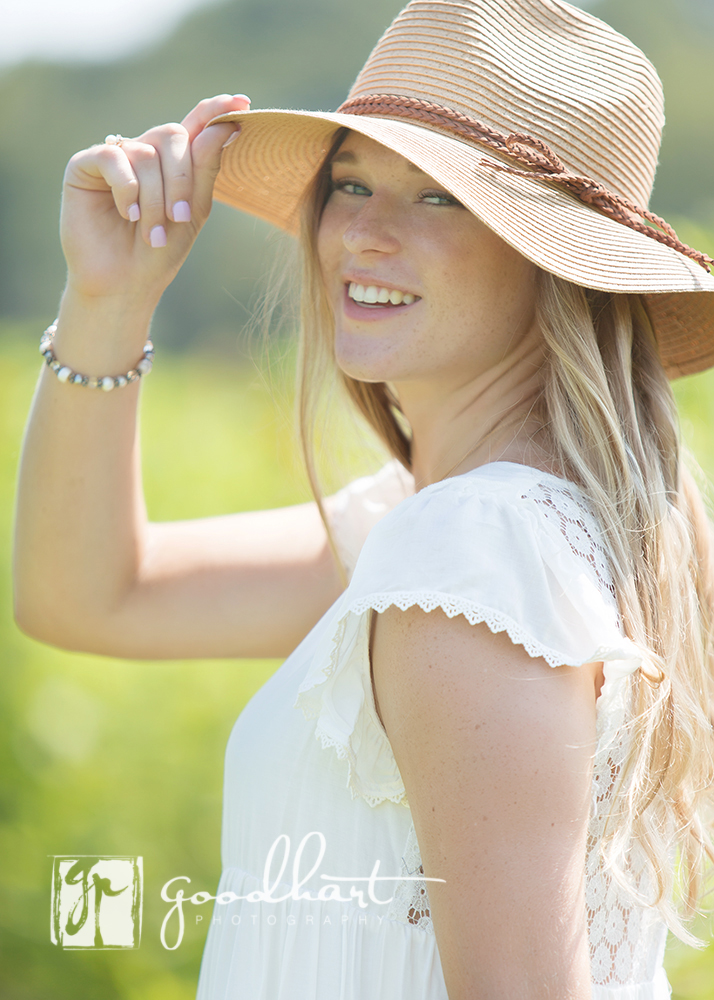 senior girl with a hat