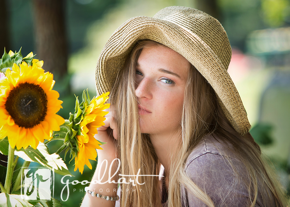senior girl with bouquet of sunflowers